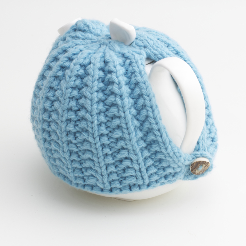 Bone China Teapot designed by Linda Bloomfield, with blue knitted cosy by Ruth Cross