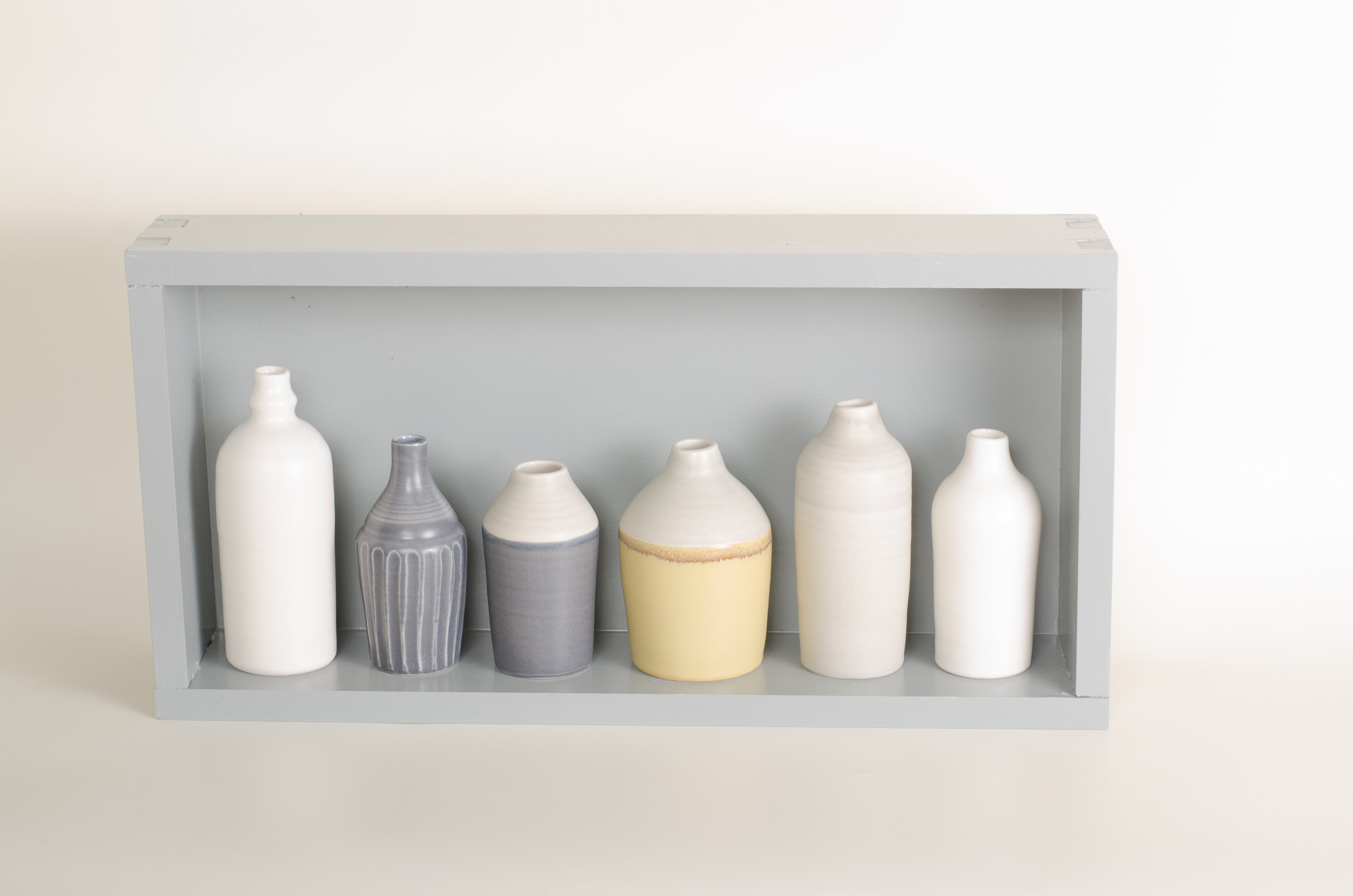 Hand thrown bottles, in white, grey, black and mustard, inspired by morandi paintings.