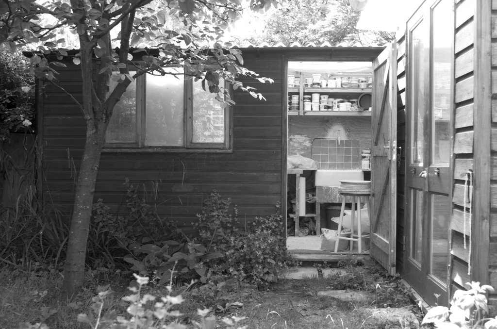 studio- garden studio- pottery shed- spring- black and white