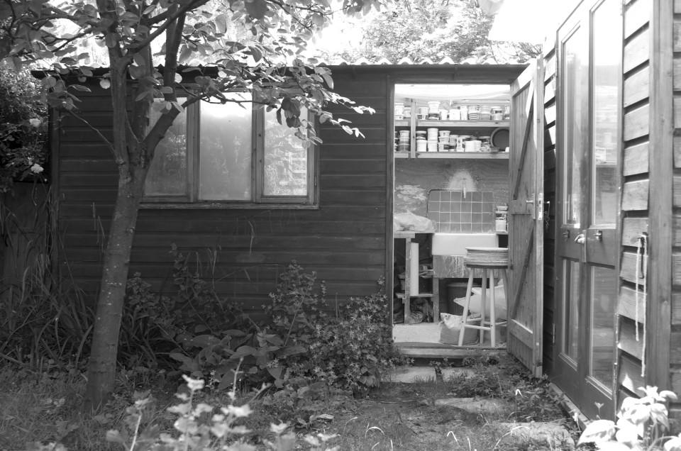 studio- garden studio- pottery shed- spring- black and white