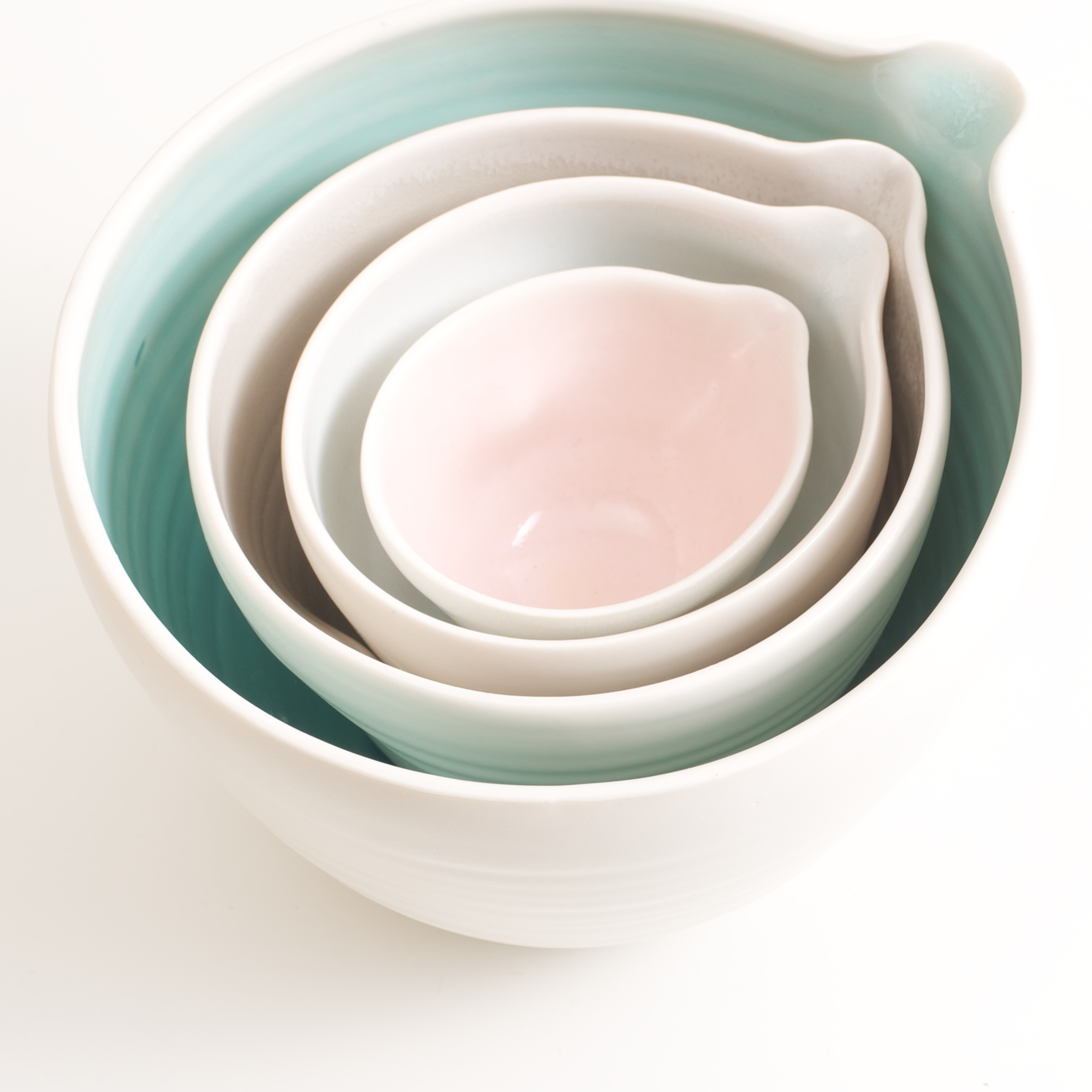 pouring bowl- handmade porcelain- tableware- cookware- dinnerware- turquoise pourer- dimpled porcelain- baking- mixing bowls- pink- blue-grey-turquoise