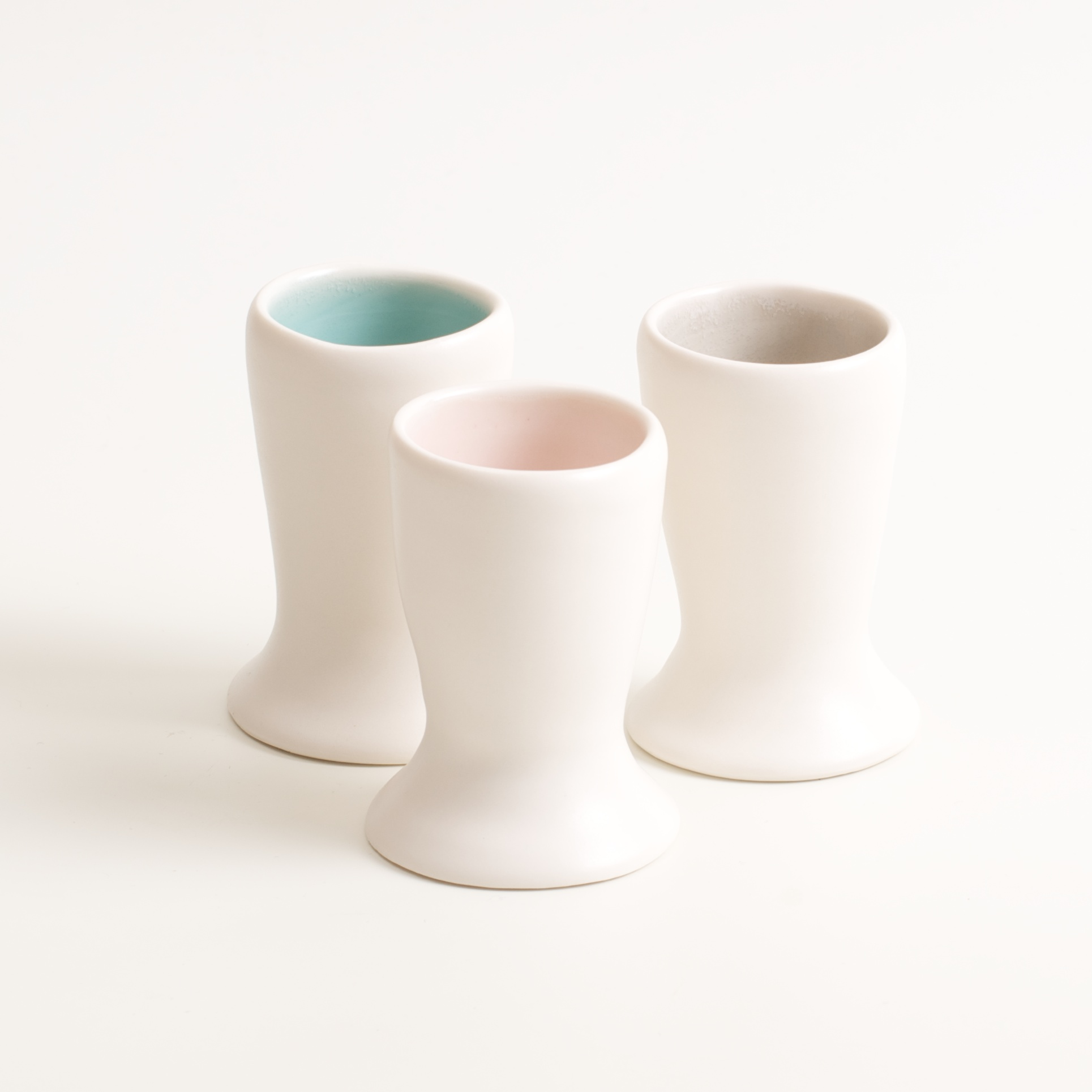 handmade porcelain- tableware- dinnerware- breakfast- eggs- build eggs- egg cup- turquoise - grey- pink
