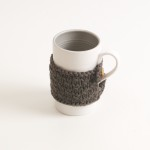 porcelain tableware- made in china- grey mug- linda bloomfield- porcelain designer- tableware designer- ruth cross- knitted cosy- mug cosy