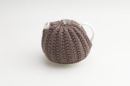 Bone China Teapot designed by Linda Bloomfield, with brown knitted cosy by Ruth Cross