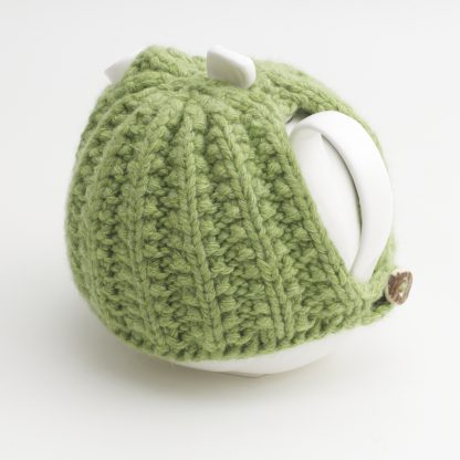 Bone China Teapot designed by Linda Bloomfield, with green knitted cosy by Ruth Cross