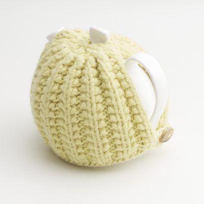 Bone China Teapot designed by Linda Bloomfield, with zesty lemon knitted cosy by Ruth Cross