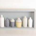 Hand thrown bottles, in white, grey, black and mustard, inspired by morandi paintings.