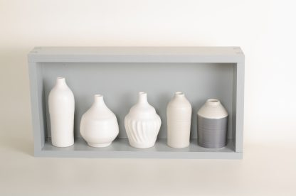 Hand thrown bottles, in white, grey, and black, inspired by morandi paintings.