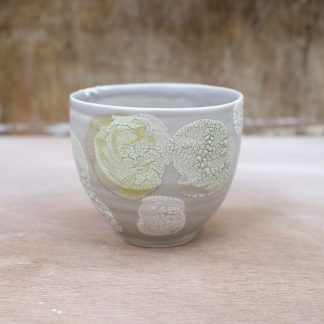 grey and yellow bowl
